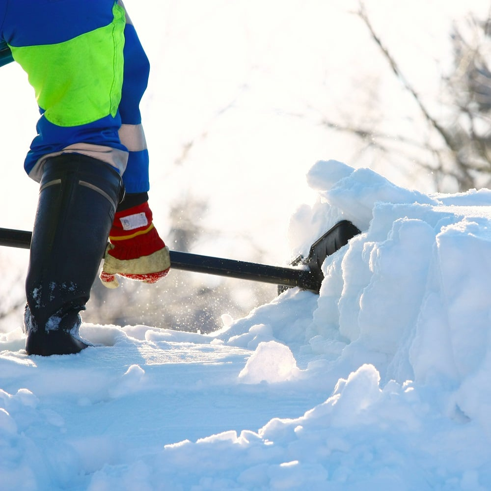 Rooftop snow removal safely