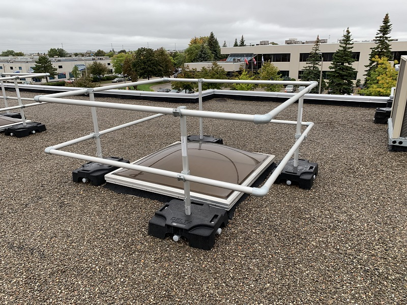 Fall protection system installed around light well