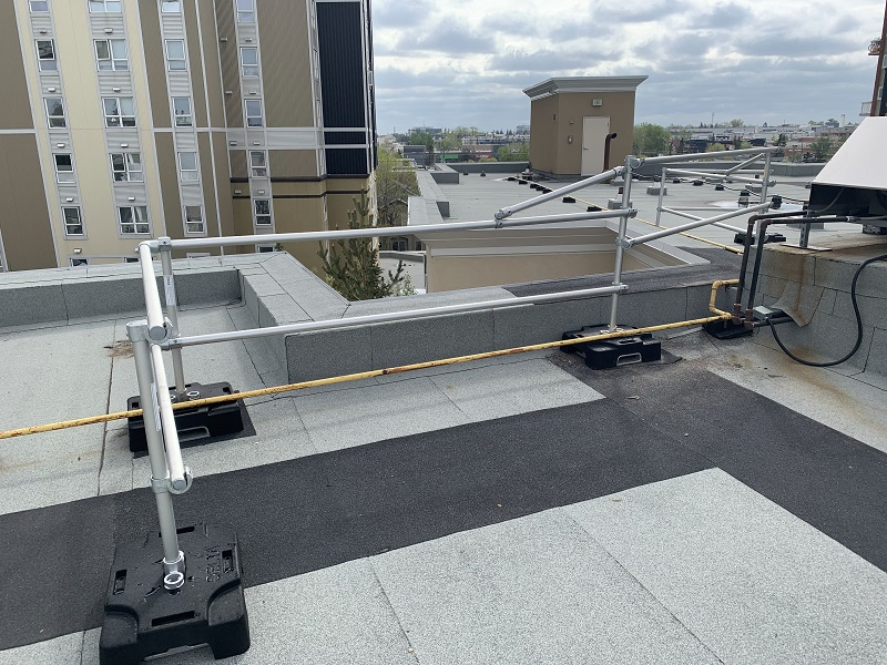 Calgary building protected by rooftop guardrail